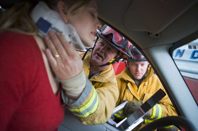 2125122-firefighters-helping-an-injured-woman-in-a-car